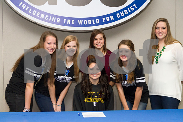 Photo by Shannon Wilson / Tyler Morning Telegraph Rilee Miller, a senior from Grace Community High School, poses with her volleyball teammates after signing with Tyler Junior College for volleyball on Wednesday morning in the conference room at Grace Community High School.