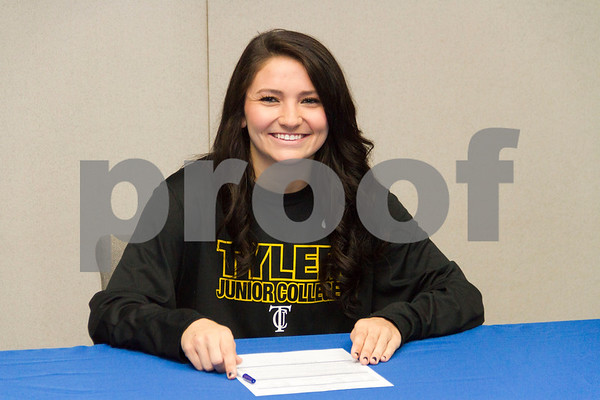 Photo by Shannon Wilson / Tyler Morning Telegraph Rilee Miller, a senior from Grace Community High School, smiles for photos after signing with Tyler Junior College for volleyball on Wednesday morning in the conference room at Grace Community High School.