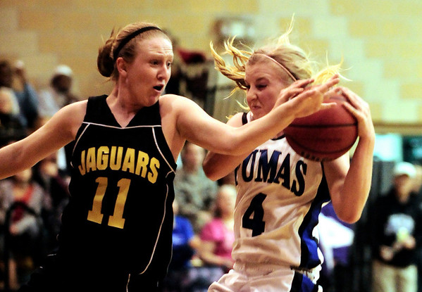 Peak to Peak's Linnea Danielson (right) nearly collides with Jefferson Academy's Madison Page (left) during their game in Lafayette, Colorado February 10, 2011.  CAMERA/Mark Leffingwell