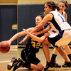 Peak to Peak's Ivy DeVries (right) fights Jefferson Academy's Nicole St. Clair (left) during their game in Lafayette, Colorado February 10, 2011.  CAMERA/Mark Leffingwell