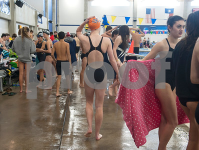 As the lone swimmer for her school, Brook Hill senior Bailey Bickerstaff walks alone to the warm up pool before competing in the 100 yard butterfly during the TAPPS North Region Championships Friday Jan. 29, 2016 held at Mansfield ISD Natatorium.   (Sarah A. Miller/Tyler Morning Telegraph)