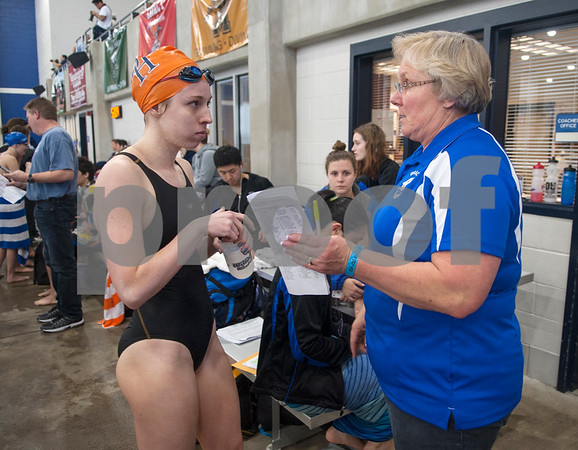 Brook Hill School senior Bailey Bickerstaff, 18, of Tyler, gets advice from her club swimming coach Janet Taylor after competing during the TAPPS North Region Championships Friday Jan. 29, 2016 held at Mansfield ISD Natatorium. Bickerstaff's Brook Hill School coach is her father Kerry Bickerstaff. Taylor is also the coach of the Grace Community School swim team.  (Sarah A. Miller/Tyler Morning Telegraph)