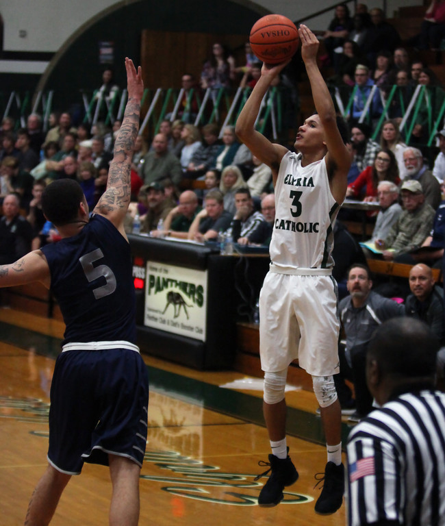 . Dorian Crutcher of Elyria Catholic shoots a three over David Weatherington of Lorain during the second quarter. Randy Meyers -- The Morning Journal