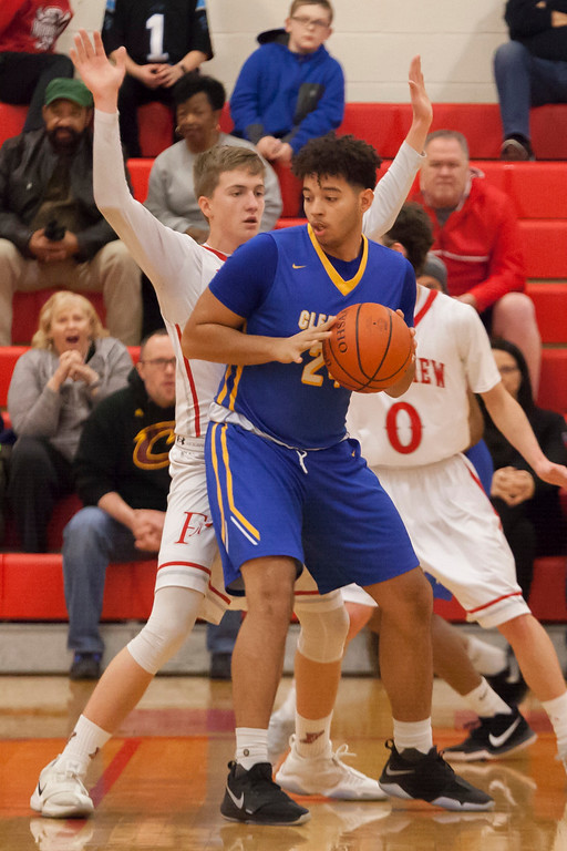 . Clearview\'s Anthony Terry looks for assistance from his fellow Clippers with Fairview\'s Colin Caja blocking his path to the basket. Jen Forbus -- The Morning Journal