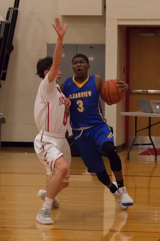 . Darien Jackson of Clearview drives the baseline as Fairview\'s Owen Morrison defends. Jen Forbus -- The Morning Journal