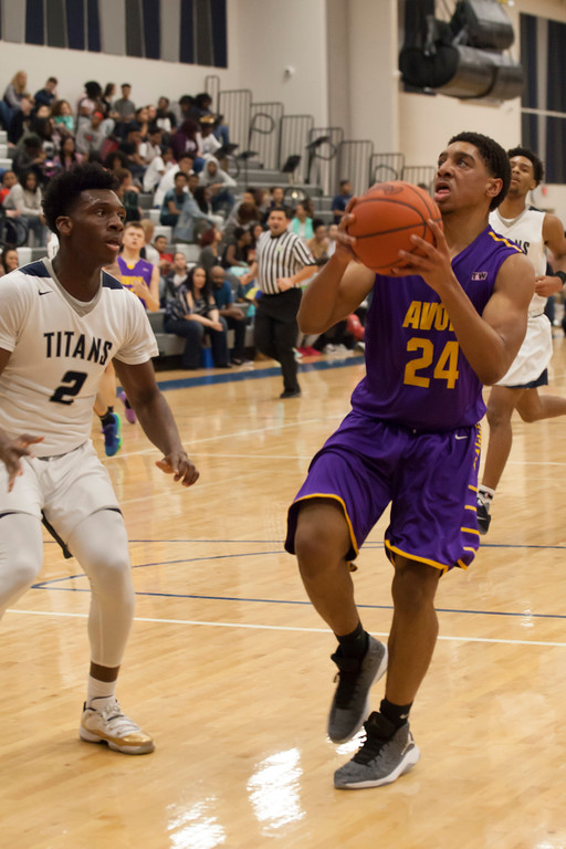 . Lorain\'s Taevon Pierre-Louis prepares to pounce on a shot from Avon\'s Ronier Barrett-Reed. Jen Forbus -- The Morning Journal