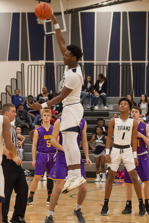 . Lorain\'s Taevon Pierre-Louis easily wins the tipl to start Tuesday\'s contest between the Titans and the Eagles. Jen Forbus -- The Morning Journal