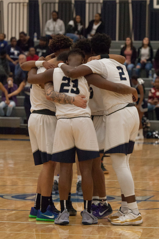 . Lorain\'s starters huddle together before the game\'s starting jump ball. Jen Forbus -- The Morning Journal