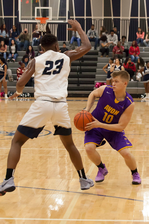 . Eagle Jacob Chasteen looks for a path around Titan Jaiden Sledge\'s defense. Jen Forbus -- The Morning Journal