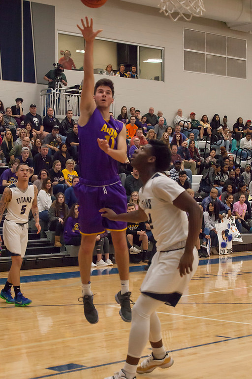. Avon\'s Vlasi Pappas gets some vertical to put a shot up over Lorain\'s Taevon Pierre-Louis. Jen Forbus -- The Morning Journal