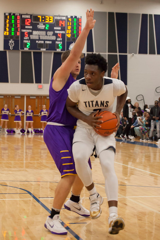 . Lorain\'s Taevon Pierre-Louis seems to be walking--running--on winged feet as Avon\'s Max Torbert tries to impede his path to the basket. Jen Forbus -- The Morning Journal