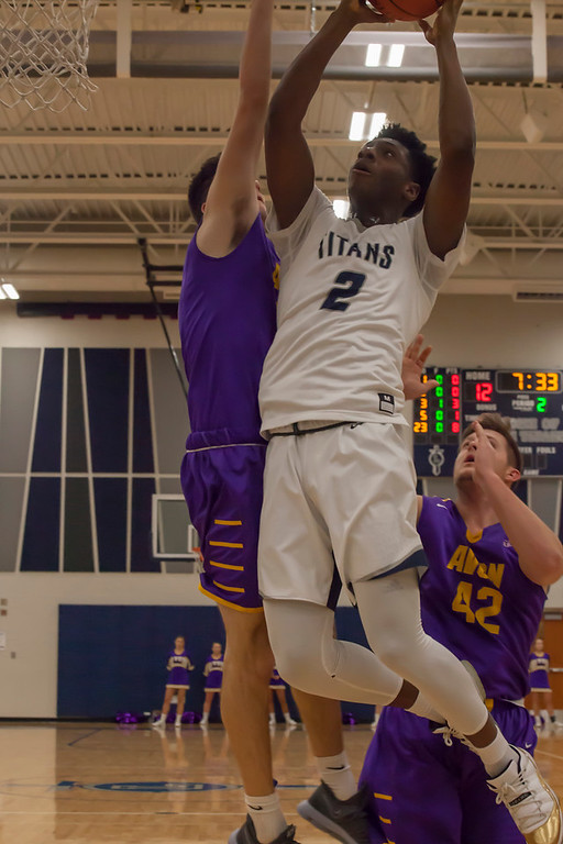 . Lorain\'s Taevon Pierre-Louis takes flight with the basketball rim as his destination. Jen Forbus -- The Morning Journal