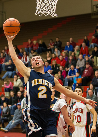Wilmington's Jesse Hilliard looks to finish the play after being fouled in the first half of Thursday night's matchup with Fairview.