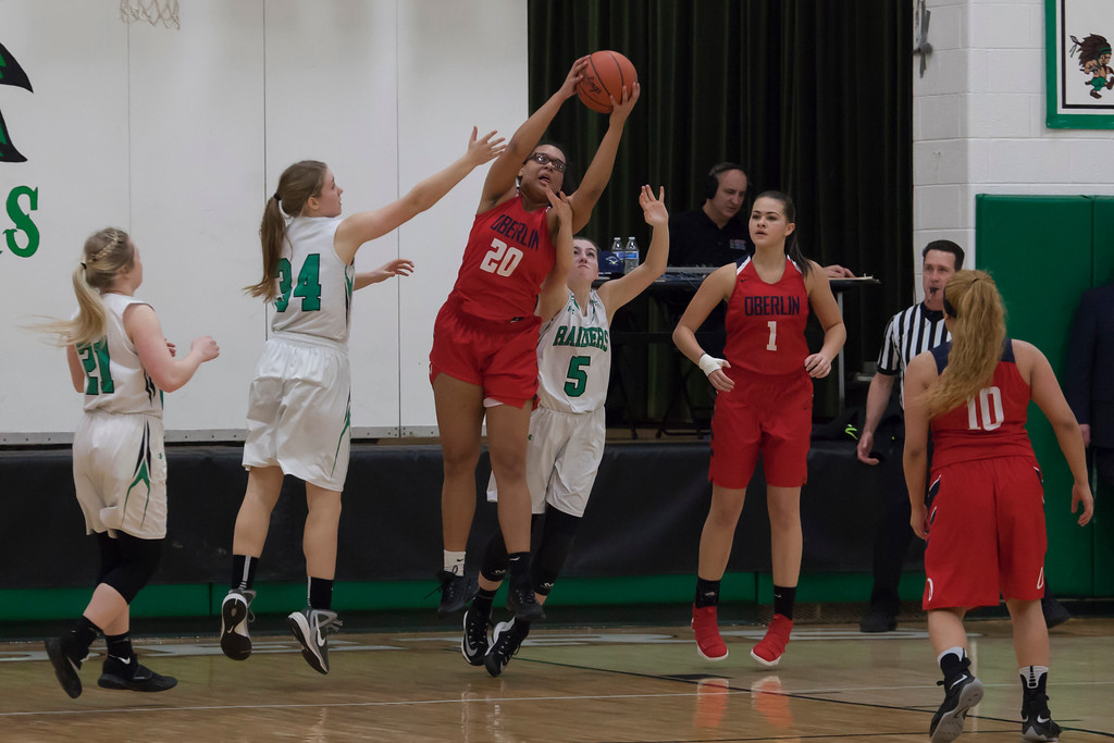 . Phoenix Karissa Rankin snatches a rebound between Raiders Jill Grzywna (5) and Emma Roberts (34). Jen Forbus -- The Morning Journal