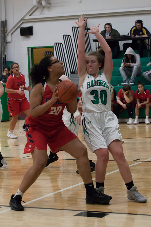 . Oberlin\'s Karissa Rankin takes aim at the basket around Columbia\'s Madison Spirnak. Jen Forbus -- The Morning Journal