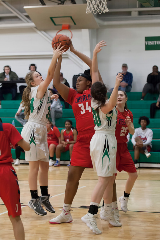 . Oberlin\'s Aniya Smith (34) and Columbia\'s Emma Roberts via for a rebound. Jen Forbus -- The Morning Journal