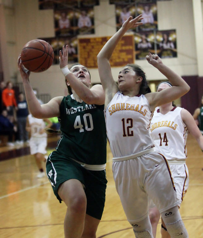 . Angela Campo of Westlake drives and scores against Arianna Negron of Avon Lake during the third quarter. Randy Meyers -- The Morning Journal