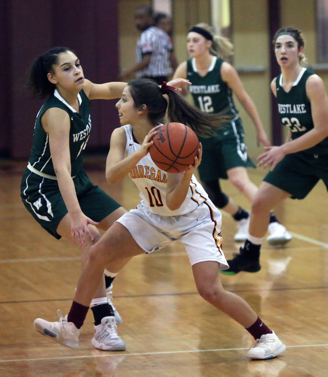 . Amber Achladis of Avon Lake looks to pass around the half court pressure applied by the Westlake defense. Randy Meyers -- The Morning Journal