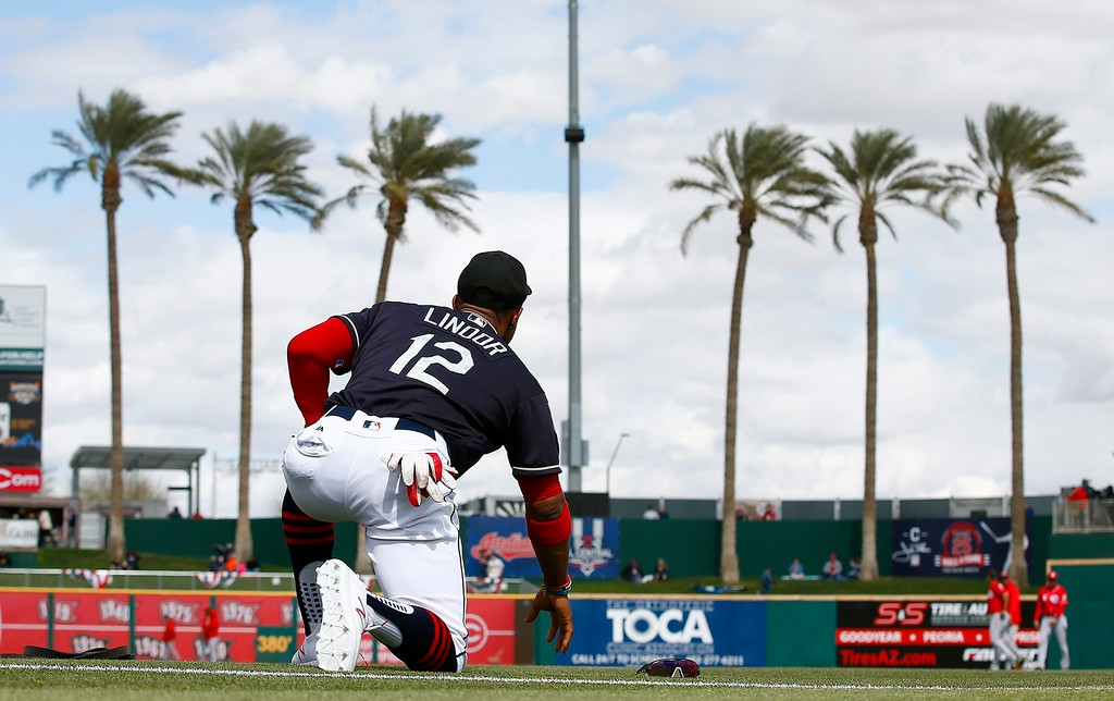 . Cleveland Indians\' Francisco Lindor stretches prior to a spring training baseball game against the Cincinnati Reds on Friday, Feb. 23, 2018, in Goodyear, Ariz. (AP Photo/Ross D. Franklin)