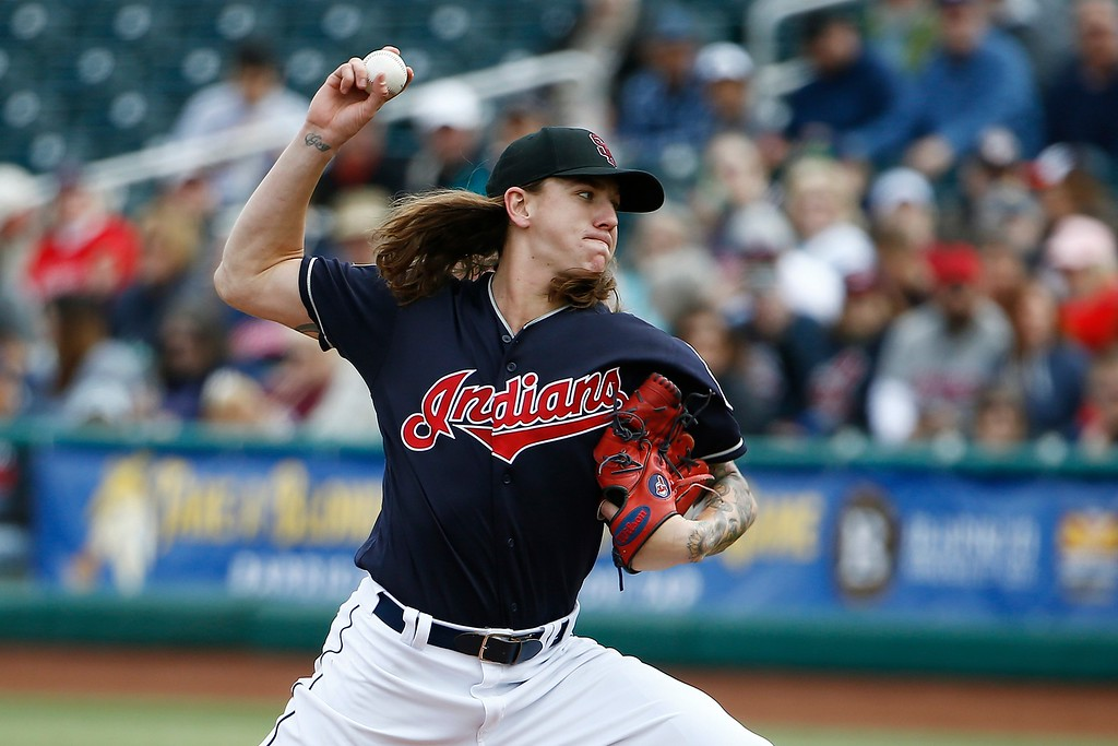 . Cleveland Indians\' Mike Clevinger throws a pitch against the Cincinnati Reds during the first inning of a spring training baseball game Friday, Feb. 23, 2018, in Goodyear, Ariz. (AP Photo/Ross D. Franklin)
