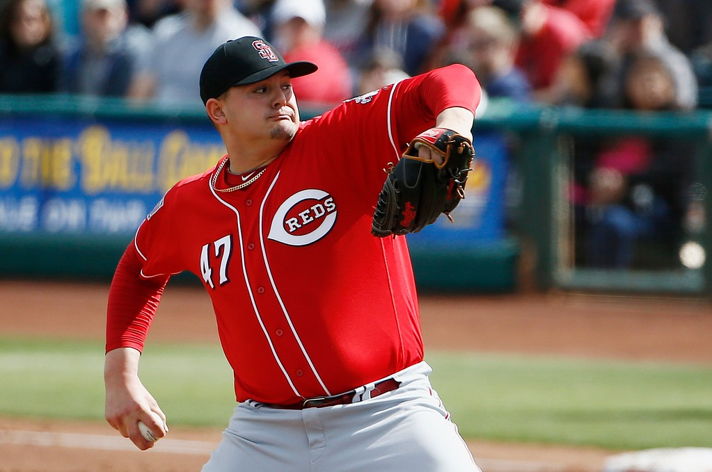 . Cincinnati Reds\' Sal Romano throws a pitch against the Cleveland Indians during the second inning of a spring training baseball game Friday, Feb. 23, 2018, in Goodyear, Ariz. (AP Photo/Ross D. Franklin)