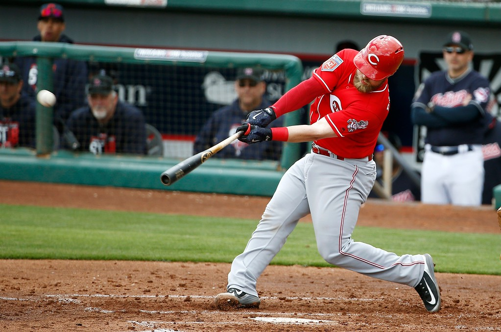 . Cincinnati Reds\' Tucker Barnhart hits a two-run home run against the Cleveland Indians during the third inning of a spring training baseball game Friday, Feb. 23, 2018, in Goodyear, Ariz. (AP Photo/Ross D. Franklin)
