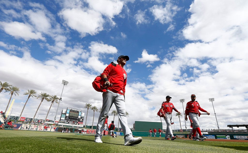 . Cincinnati Reds\' Mason Williams, left, Jose Siri (85) and Eugenio Suarez (7) walk on the field prior to a spring training baseball game against the Cleveland Indians, Friday, Feb. 23, 2018, in Goodyear, Ariz. (AP Photo/Ross D. Franklin)
