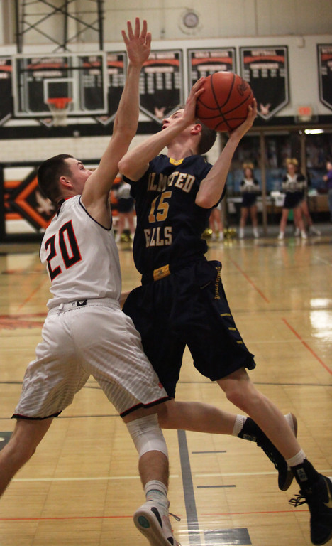 . Tom Lloyd of Olmsted Falls is fouled on the drive by Sean Elbin of North Olmsted during the first quarter. Randy Meyers -- The Morning Journal
