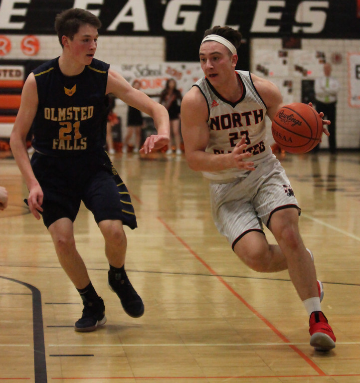. Darren Anders of North Olmsted drives by Ryan Higgenbotham of Olmsted Falls during the second quarter. Randy Meyers -- The Morning Journal