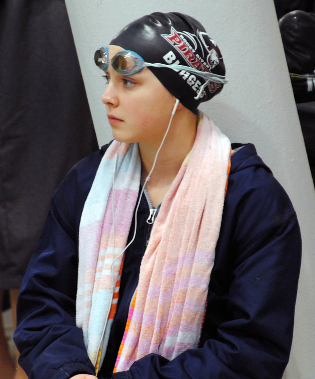. Jon Behm - The Mornign Journal<br> Rocky River junior Katherine Burgess listens to some music while waiting for her 100 breaststroke heat at the Division I state meet on Feb. 24 at the C.T. Branin Natatorium in Canton. Burgess finished 15th win a time of 1:06.53.