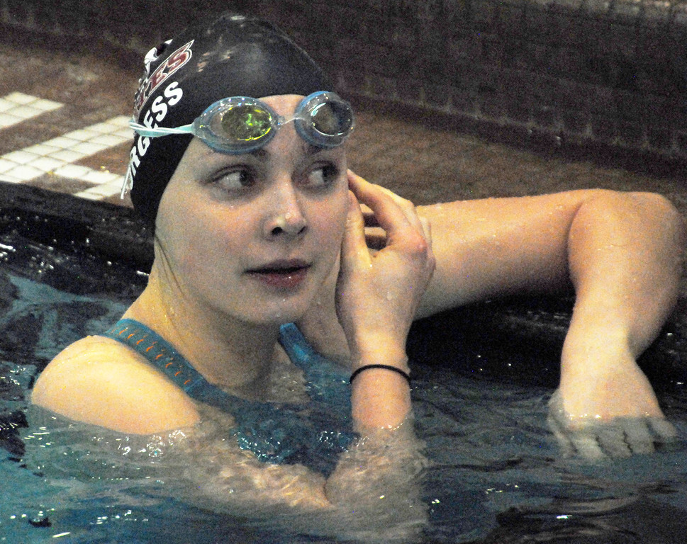 . Jon Behm - The Mornign Journal<br> Rocky River junior Katherine Burgess checks the scoreboard for her time following her 100 breaststroke swim at the Division I state meet on Feb. 24 at the C.T. Branin Natatorium in Canton. Burgess finished 15th win a time of 1:06.53.