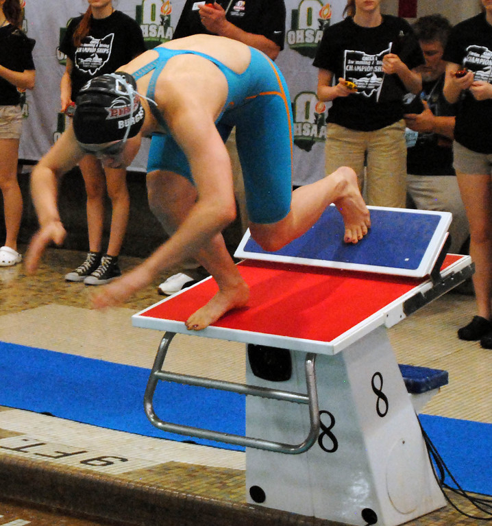 . Jon Behm - The Mornign Journal<br> Rocky River junior Katherine Burgess leaps from the block to start her 100 breaststroke heat at the Division I state meet on Feb. 24 at the C.T. Branin Natatorium in Canton. Burgess finished 15th win a time of 1:06.53.