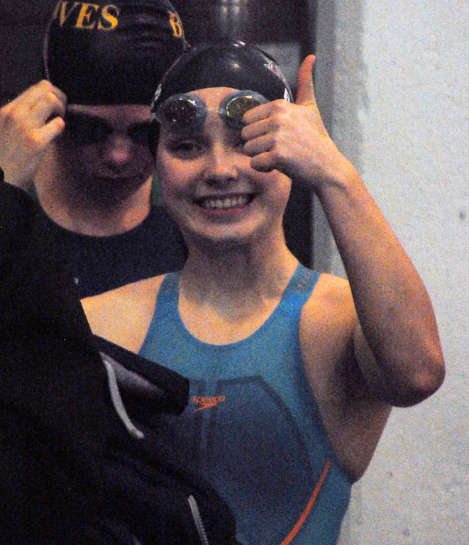 . Jon Behm - The Mornign Journal<br> Rocky River junior Katherine Burgess flashes a smile and thumbs up to her teammates as she prepares for her 100 breaststroke heat at the Division I state meet on Feb. 24 at the C.T. Branin Natatorium in Canton. Burgess finished 15th win a time of 1:06.53.