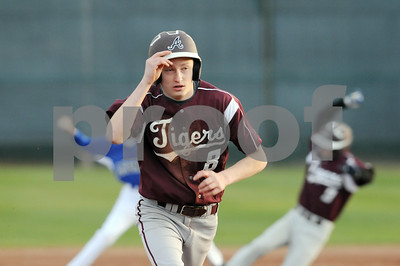 photo by Sarah A. Miller/Tyler Morning Telegraph  Arp's (8) Gabe Reynolds runs to second base during their game against John Tyler at Mike Carter Field in Tyler Monday.