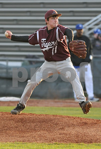 photo by Sarah A. Miller/Tyler Morning Telegraph   Arp's (11) Josh Smith pitches against JohnTyler High School at Mike Carter Field in Tyler Monday.
