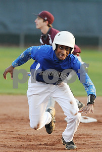 photo by Sarah A. Miller/Tyler Morning Telegraph   John Tyler's (2) Jerron Jones makes a fast dash to second base during their game against Arp at Mike Carter Field in Tyler Monday.