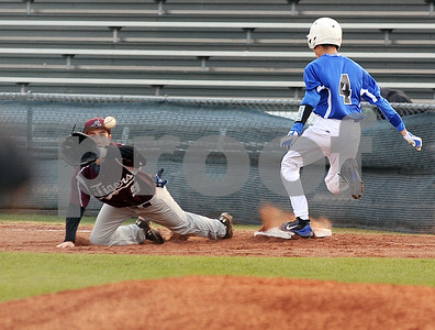 photo by Sarah A. Miller/Tyler Morning Telegraph   John Tyler's (4) Diego Martinez is safe at first base before Arp's (9) Chase Carlile makes the catch at Mike Carter Field in Tyler Monday.