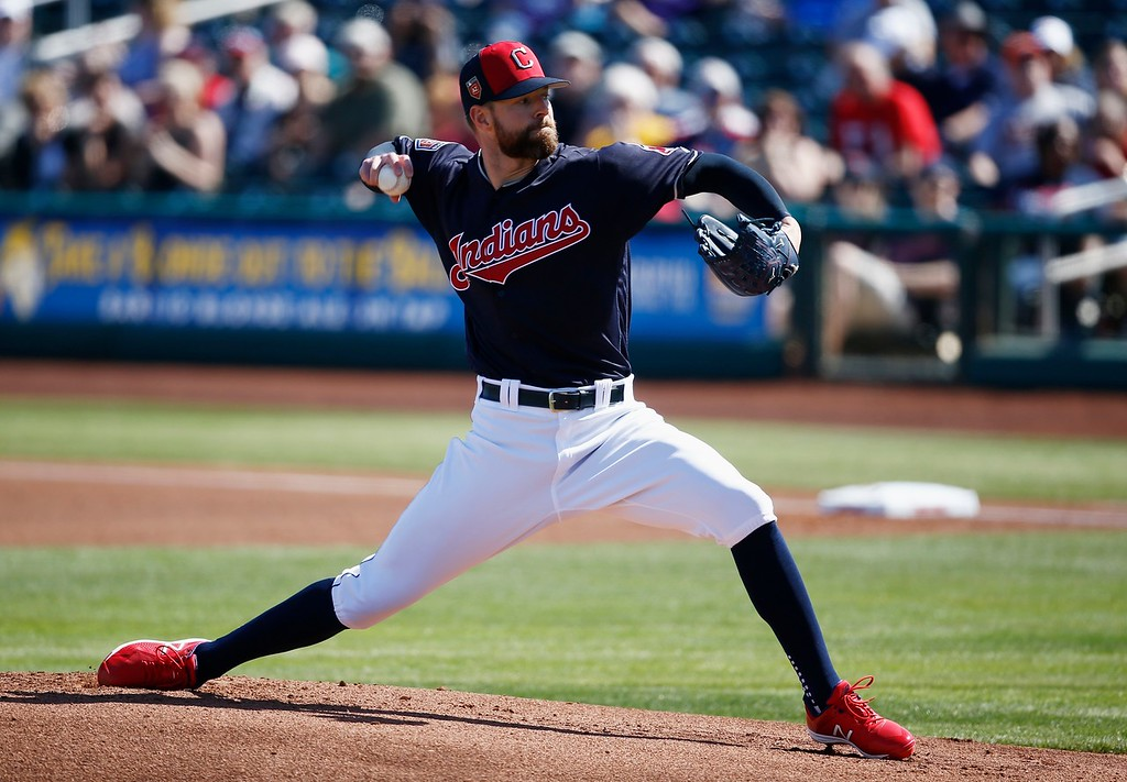 . Cleveland Indians starting pitcher Corey Kluber throws a pitch against the Oakland Athletics during the first inning of a spring training baseball game Tuesday, Feb. 27, 2018, in Goodyear, Ariz. (AP Photo/Ross D. Franklin)