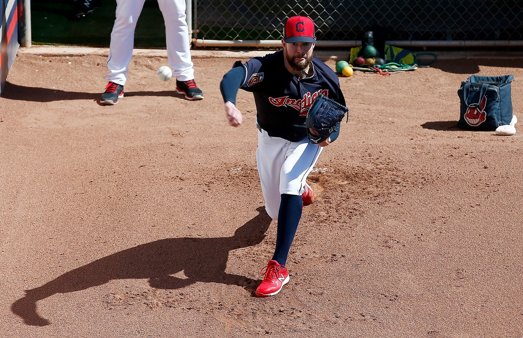. Cleveland Indians starting pitcher Corey Kluber warms up before a spring training baseball game against the Oakland Athletics, Tuesday, Feb. 27, 2018, in Goodyear, Ariz. (AP Photo/Ross D. Franklin)