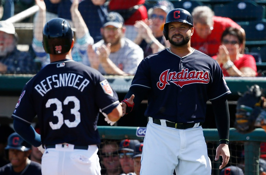 . Cleveland Indians\' Rob Refsnyder (33) celebrates his two-run home run against the Oakland Athletics with Yonder Alonso, right, during the second inning of a spring training baseball game Tuesday, Feb. 27, 2018, in Goodyear, Ariz. (AP Photo/Ross D. Franklin)