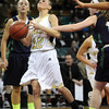 "Monarch High's Brenna Stimac (12) is fouled on her way to the basket by Thunder Ridge High's  Taylor Chase (15) during their game at the Denver Coliseum on Saturday March 3, 2012.<br /> Photo by Paul Aiken / The Daily Camera /  <a href=""http://www.bocopreps.com"">http://www.bocopreps.com</a>"