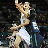 "Monarch High's Jac Malcolm-Peck shoots over Thunder Ridge High's  Taylor Williams (23) during their game at the Denver Coliseum on Saturday March 3, 2012.<br /> Photo by Paul Aiken / The Daily Camera /  <a href=""http://www.bocopreps.com"">http://www.bocopreps.com</a>"