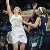"""Monarch High's Ashton Davis (13) shoots over Thunder Ridge High's  Taylor Chase (15) during their game at the Denver Coliseum on Saturday March 3, 2012.<br /> Photo by Paul Aiken / The Daily Camera /  <a href=""""http://www.bocopreps.com"""">http://www.bocopreps.com</a>"""