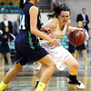"Monarch High's Jordan Eisler (40) fights her way around Thunder Ridge High's Brianna Troop (14) during their game at the Denver Coliseum on Saturday March 3, 2012.<br /> Photo by Paul Aiken / The Daily Camera /  <a href=""http://www.bocopreps.com"">http://www.bocopreps.com</a>"