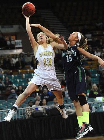 "Monarch High's Ashton Davis (13) flies to the basket as Thunder Ridge High's Taylor Chase (15) defends during their game at the Denver Coliseum on Saturday March 3, 2012.<br /> Photo by Paul Aiken / The Daily Camera /  <a href=""http://www.bocopreps.com"">http://www.bocopreps.com</a>"