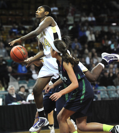 """Monarch High's Alexus Johnson (44)  over Thunder Ridge High's Taylor Williams (23)  during their game at the Denver Coliseum on Saturday March 3, 2012.<br /> Photo by Paul Aiken / The Daily Camera /  <a href=""""http://www.bocopreps.com"""">http://www.bocopreps.com</a>"""