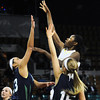 "Monarch High's Alexus Johnson (44) shoots over Thunder Ridge High's  Taylor Williams (23) and Taylor Chase  (15) during their game at the Denver Coliseum on Saturday March 3, 2012.<br /> Photo by Paul Aiken / The Daily Camera /  <a href=""http://www.bocopreps.com"">http://www.bocopreps.com</a>"