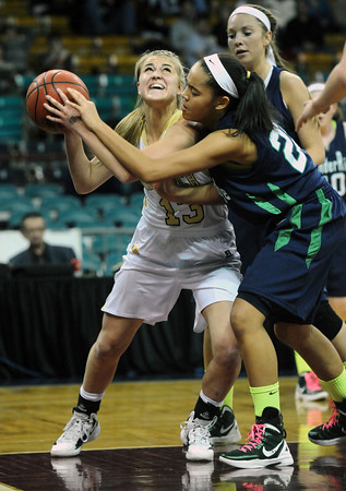 """Monarch High's Raegen Rohn (15) fights for space as Thunder Ridge High's  Taylor Williams (23) defends during their game at the Denver Coliseum on Saturday March 3, 2012.<br /> Photo by Paul Aiken / The Daily Camera /  <a href=""""http://www.bocopreps.com"""">http://www.bocopreps.com</a>"""