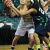 "Monarch High's Raegen Rohn (15) fights for space as Thunder Ridge High's  Taylor Williams (23) defends during their game at the Denver Coliseum on Saturday March 3, 2012.<br /> Photo by Paul Aiken / The Daily Camera /  <a href=""http://www.bocopreps.com"">http://www.bocopreps.com</a>"