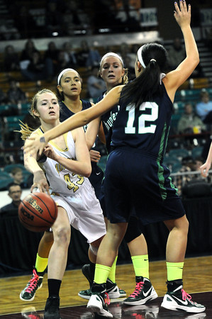 """Monarch High's Mae Williams (43) passes in traffic around Thunder Ridge High's Cara Lantzy (12) during their game at the Denver Coliseum on Saturday March 3, 2012.<br /> Photo by Paul Aiken / The Daily Camera /  <a href=""""http://www.bocopreps.com"""">http://www.bocopreps.com</a>"""